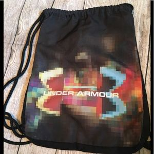 Rainbow under armour sling back pack. GUC.